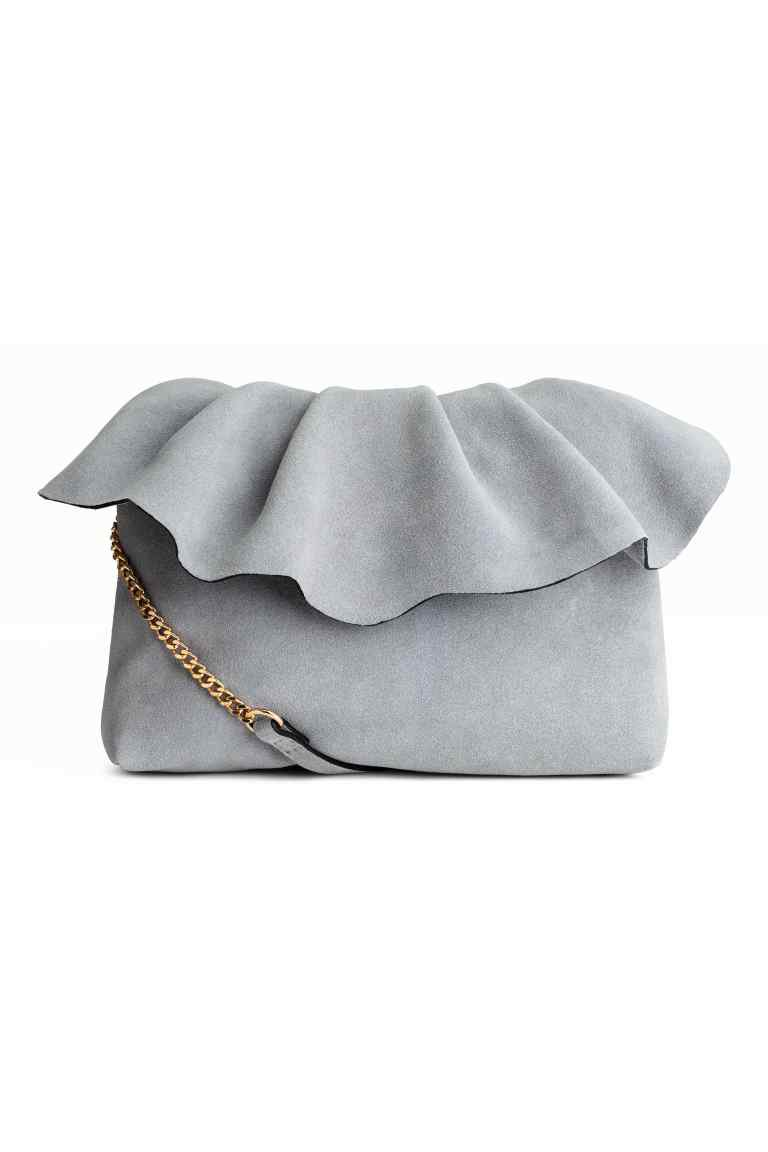 Pochette en peau de couleur gris claire de chez hette H&M
